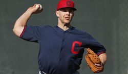 Cleveland Indians starting pitcher Justin Masterson throws during spring training baseball practice in Goodyear, Ariz., Thursday, Feb. 13, 2014. (AP Photo/Paul Sancya)