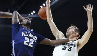 Villanova forward JayVaughn Pinkston (22) is fouled by Providence forward Carson Desrosiers (33) as he goes to the hoop during the first half of an NCAA basketball game in Providence, Tuesday, Feb. 18, 2014. (AP Photo/Elise Amendola)