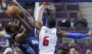 Detroit Pistons forward Josh Smith (6) reaches in and fouls Charlotte Bobcats forward Michael Kidd-Gilchrist (14) during the first quarter of an NBA basketball game in Auburn Hills, Mich., Tuesday, Feb. 18, 2014. (AP Photo/Carlos Osorio)