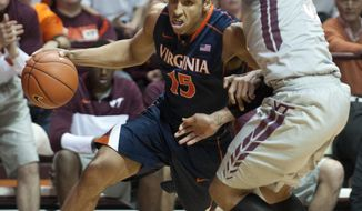 Virginia's Malcolm Brogdon (15) drives on Virginia Tech's Jarell Eddie during the first half of an NCAA college basketball game Tuesday, Feb. 18, 2014, in Blacksburg, Va. (AP Photo/Don Petersen)