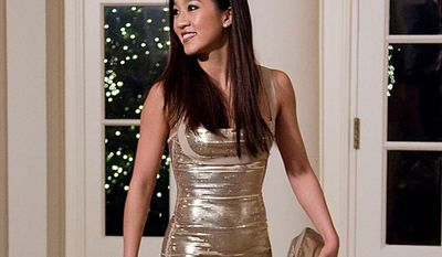 Olympic figure skater Michelle Kwan arrives at the White House in Washington, Wednesday, Jan. 19, 2011, for a state dinner in honor of China's President Hu Jintao. (AP Photo/Evan Vucci)
