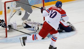 Czech Republic forward Roman Cervenka shot lands in the net during the first period of the 2014 Winter Olympics men's ice hockey game against Slovakia at Shayba Arena, Tuesday, Feb. 18, 2014, in Sochi, Russia. (AP Photo/Petr David Josek)