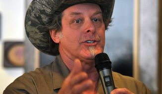 Longtime rocker Ted Nugent speaks to a crowd of Greg Abbott supporters during a campaign stop in Wichita Falls, Texas on Tuesday, Feb. 18, 2014. Abbott welcomed salty-tongued rocker Ted Nugent to his campaign for Texas governor on Tuesday but claimed ignorance about inflammatory remarks his polarizing surrogate has made on immigration and women. (AP Photo/Wichita Falls Times Record News, Torin Halsey)
