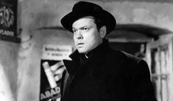 """Orson Welles plays Harry Lime in a scene of Carol Reed's movie """"The Third Man"""". The documentary """"Shadowing the Third Man,"""" which played at the Cannes Film Festival, chronicles the serendipity that turned Reed's 1949 caper into arguably the greatest postwar tale about the new world order of moral ambiguity. (AP Photo/HO) ** NO SALES **"""