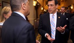 """House Oversight and Government Reform Committee Chairman Rep. Darrell Issa, R-Calif., right, talks with Albert Douglas, a Selectman from Pittsfield, N.H. Monday, Feb. 17, 2014, at the Concord City and Merrimack County Republican Committee Lincoln-Reagan Day Dinner in Concord, N.H. Issa, who is spearheading investigations of President Barack Obama's administration by the GOP-run House urged his party Tuesday to unite against Obama's """"imperial presidency"""". (AP Photo/Jim Cole)"""