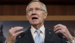 ** FILE ** In this Feb. 6, 2014, file photo, Senate Majority Leader Harry Reid, D-Nev., speaks on Capitol Hill in Washington. (AP Photo/J. Scott Applewhite, File)