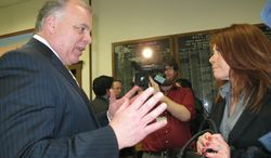 """New Jersey state Senate President Steve Sweeney, left, speaks with Yvonne Lopez, right, an official with the Puerto Rican Association for Human Development following a press conference in Perth Amboy N.J. on Feb. 19, 2014. Sweeney was pushing for his proposed """"Sandy Bill Of Rights,"""" saying Gov. Chris Christie's administration's handling of Superstorm Sandy aid has  been """"a colossal failure."""" (AP Photo/Wayne Parry)"""