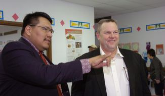 Crow Indian Reservation tribe chairman, Darrin Old Coyote, left, and U.S. Sen. Jon Tester, D-Mont., tour the Head Start education center in Crow Agency, Mont., on Wednesday, Feb. 19, 2014. U.S. Sen. Jon Tester says he'll use his new role as chairman of the U.S. Senate Indian Affairs Committee to target wasteful spending, improve educational opportunities and promote job development on reservations. (AP Photo/Matthew Brown)