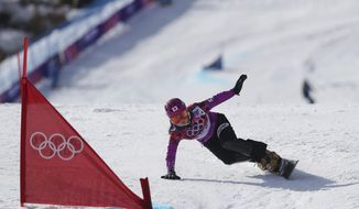 Japan's Tomoka Takeuchi competes in the women's snowboard parallel giant slalom semifinal at the Rosa Khutor Extreme Park, at the 2014 Winter Olympics, Wednesday, Feb. 19, 2014, in Krasnaya Polyana, Russia. Takeuchi took the silver medal. (AP Photo/Sergei Grits)