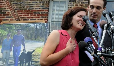 ASSOCIATED PRESS Berwyn Heights Mayor Cheye Calvo and his wife, Trinity Tomsic, seen at their home in this file photo after their dogs were killed in a raid by Prince George's County deputies last year, were told the deputies acted appropriately.