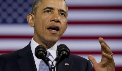 ** FILE ** President Barack Obama speaks about how having a fuel-efficient truck fleet can boost the economy and help combat climate change, Tuesday, Feb. 18, 2014, at the Safeway Distribution Center in Upper Marlboro, Md. (AP Photo/Jacquelyn Martin)
