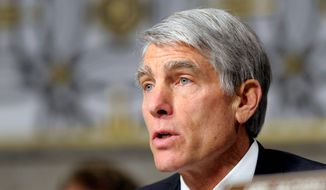 Critics turned up the heat on Sen. Mark Udall, Colorado Democrat, after it was revealed he was among those invited to billionaire Tom Steyer's Democratic Senatorial Campaign Committee fund-raiser. (Associated Press)