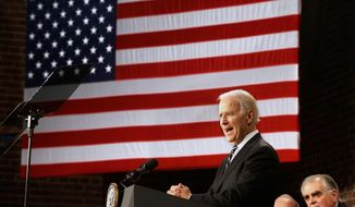 Vice President Joe Biden speaks at America's Central Port in Granite City, Ill., Wednesday, Feb. 19, 2014, to mark the fifth anniversary of the American Recovery and Reinvestment Act (ARRA). At right is former Transportation Secretary Ray LaHood. (AP Photo/Seth Perlman)