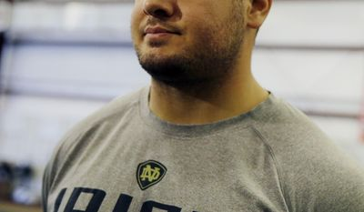 "In this Feb. 14, 2014 photo, Notre Dame linebacker Carlo Calabrese listens to a question between training sessions at TEST Sports Clubs in Martinsville, N.J. College players from across the country come here to prepare for the NFL scouting combine in Indianapolis, the regional combines and their pro days. Running a faster 40 is more about proper upper-body technique than simple speed and footwork. Many players (and journalists) don't learn this until they join the program.""I didn't know that in the beginning,""  Calabrese said. ""Arms play a big part in it."" (AP Photo/Mel Evans)"
