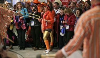 Dutch band Kleintje Pils, or Little Beer, entertains spectators at the Adler Arena Skating Center prior to the start of the men's 10,000-meter speedskating race during the 2014 Winter Olympics in Sochi, Russia, Tuesday, Feb. 18, 2014. (AP Photo/Matt Dunham)