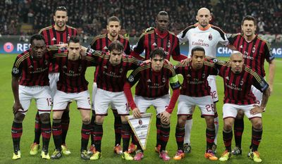 AC Milan's players, background from left, Adil Rami, Adel Taarabt, Mario Balotelli, goalie Christian Abbiati, Daniele Bonera, front row from left, Michael Essien, Mattia De Sciglio, Andrea Poli, Ricardo Kaka, Urby Emanuelson, and Nigel De Jong, pose for a picture before the start of a round of 16th Champions League soccer match between AC Milan and Atletico Madrid at the San Siro stadium in Milan, Italy, Wednesday, Feb. 19, 2014. (AP Photo/Emilio Andreoli)