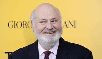 """Actor-director Rob Reiner smiles at the premiere of """"The Wolf of Wall Street"""" in New York, Dec. 17, 2013. (Photo by Evan Agostini/Invision/AP) ** FILE **"""
