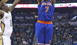 New York Knicks small forward Carmelo Anthony (7) shoots the ball over New Orleans Pelicans small forward Al-Farouq Aminu (0) during the first quarter of an NBA basketball game in New Orleans, Wednesday, Feb. 19, 2014. (AP Photo/Jonathan Bachman)