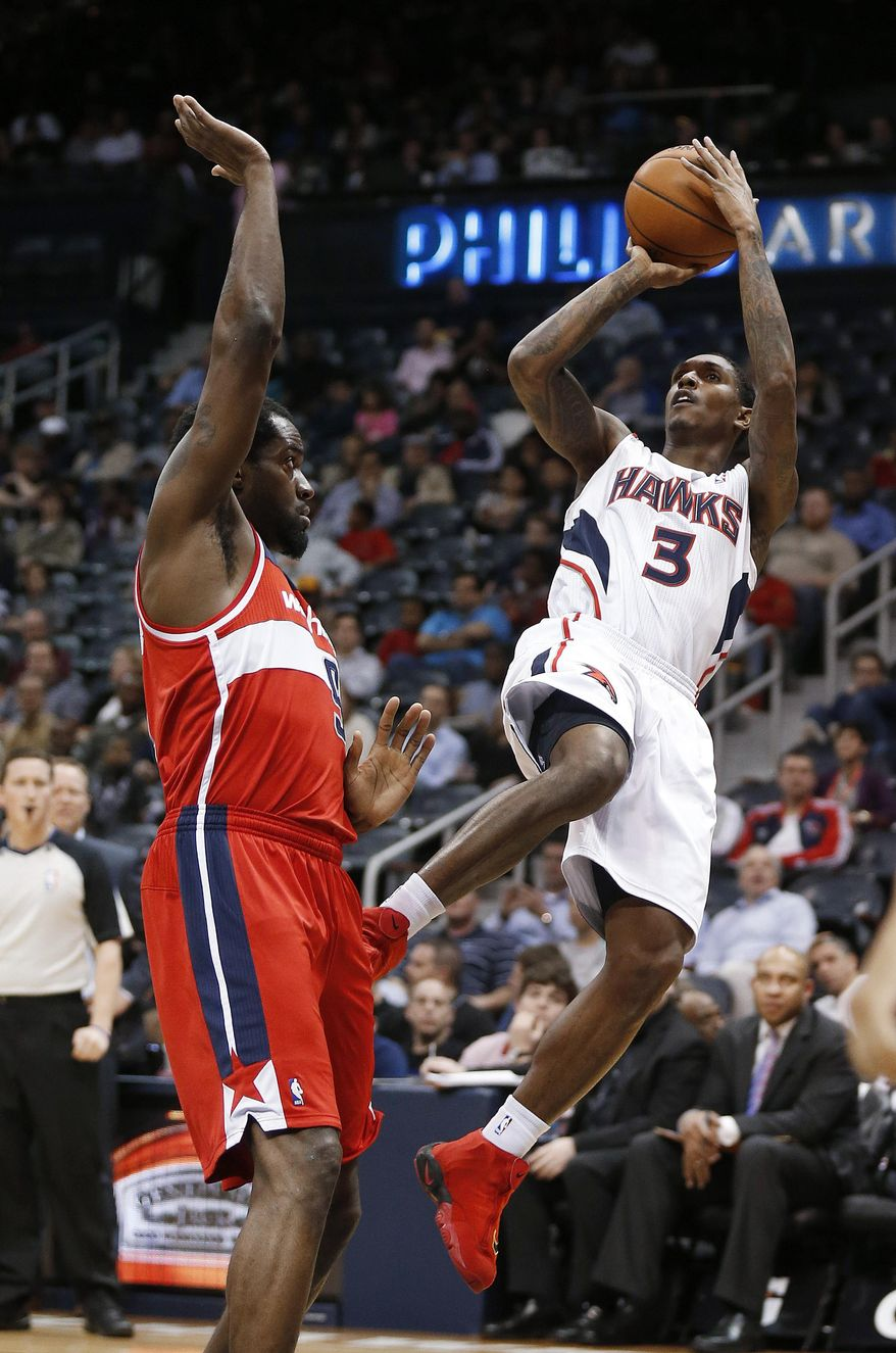 Atlanta Hawks guard Louis Williams (3) takes a shot against Washington Wizards forward Martell Webster (9) during the first half of an NBA basketball basketball game Wednesday, Feb. 19, 2014, in Atlanta. (AP Photo/John Bazemore)