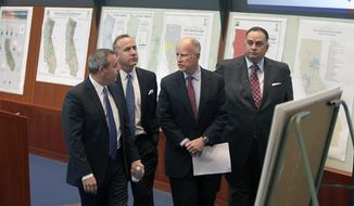 California Gov. Jerry Brown, third from left, is given a tour of the California Emergency Services State Operations Center by OES Director Mark Ghilarducci, left, in Mather, Calif., Wednesday, Feb. 19, 2014. Brown, accompanied by Senate President Pro Tem Darrell Steinberg, D-Sacramento, second from left, and Assembly Speaker John Perez, D-Los Angeles, right, toured the facility before  announcing a $687 million plan to provide immediate help to drought-stricken communities throughout California. (AP Photo/Rich Pedroncelli)