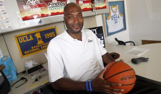 FILE - In this Sept. 18, 2010, file photo, former UCLA basketball player Ed O'Bannon Jr. sits in his office in Henderson, Nev.  His landmark suit demanding college players get some of the hundreds of millions of dollars they generate every year could change the way big time college athletics are operated. (AP Photo/Isaac Brekken, File)