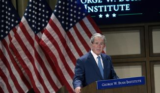 """Former President George W. Bush speaks  during a summit titled """"Empowering Our Nation's Warriors,""""  held at the George W. Bush Institute at Southern Methodist University Wednesday, Feb. 19, 2014, in Dallas. Bush's policy institute is hosting the summit on helping veterans transition to civilian life. (AP Photo/LM Otero)"""