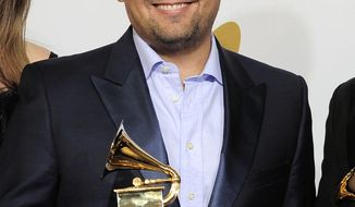 "FILE - This Feb. 12, 2012 file photo shows songwriter Robert Lopez backstage with his award for best musical theater album for ""The Book of Mormon"" at the 54th annual Grammy Awards in Los Angeles. Lopez, who helped create ""Avenue Q"" and ""The Book of Mormon,"" is up for an Academy Award next month along with his co-writing partner and wife, Kristen Anderson-Lopez, for best song for ""Let it Go"" from the animated film ""Frozen."" (AP Photo/Mark J. Terrill, File)"