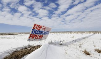 "FILE - In this March 11, 2013 photo, a sign reading ""Stop the Transcanada Pipeline"" stands in a field near Bradshaw, Neb., along the Keystone XL pipeline route through the state. A Nebraska district court struck down a law that allowed the Keystone XL oil pipeline to proceed through the state, Wednesday, Feb. 19, 2014. The law could have been used to force landowners to allow the pipeline on their property. (AP Photo/Nati Harnik, File)"