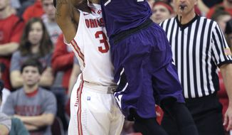 Northwestern's Drew Crawford, right, shoots over Ohio State's Lenzelle Smith during the second half of an NCAA college basketball game Wednesday, Feb. 19, 2014, in Columbus, Ohio. Ohio State defeated Northwestern 76-60. (AP Photo/Jay LaPrete)