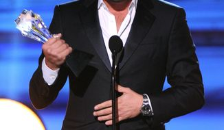 """FILE - In this Jan. 16, 2014 file photo, Leonardo DiCaprio accepts the award for best actor in a comedy for """"The Wolf of Wall Street"""" at the 19th annual Critics' Choice Movie Awards at the Barker Hangar, in Santa Monica, Calif.  DiCaprio is also nominated for an Academy award for his performance by an actor in a leading role for the film. (Photo by Frank Micelotta/Invision/AP, file)"""