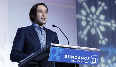 """FILE - In this Jan. 29, 2011 file photo, director Danfung Dennis accepts the World Cinema Grand Jury Prize: Documentary for """"Hell and Back Again"""" during the 2011 Sundance Film Festival Awards Ceremony in Park City, Utah. Dennis' latest project: a virtual reality documentary, """"Zero Point,"""" will be the first movie released for the Oculus Rift, a VR headset that provides an immersive 110-degree field of view with high-definition stereoscopic 3D and low-latency head tracking. (AP Photo/Danny Moloshok, File)"""
