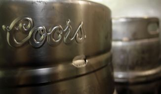 **FILE** Barrels of Coors beer wait for distribution to stands in Coors Field in Denver on Wednesday, Aug. 8, 2007. (AP Photo/David Zalubowski)