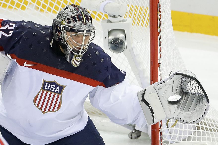 USA goaltender Jonathan Quick catches a shot on the goal during the first period of men's quarterfinal hockey game against the Czech Republic in Shayba Arena at the 2014 Winter Olympics, Wednesday, Feb. 19, 2014, in Sochi, Russia. (AP Photo/Matt Slocum)