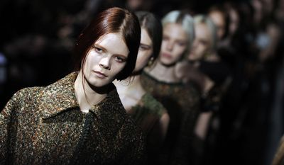 Models wear creations for Alberta Ferretti women's Fall-Winter 2014-15 collection, part of the Milan Fashion Week, unveiled in Milan, Italy, Wednesday, Feb. 19, 2014. (AP Photo/Giuseppe Aresu)