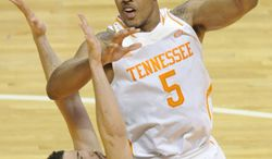 Tennessee forward Jarnell Stokes (5) shoots over Georgia forward Nemanja Djurisic (42) during the second half of an NCAA college basketball game in Knoxville, Tenn., on Tuesday, Feb. 18, 2014. Tennessee defeated Georgia 67-48. (AP Photo/The Knoxville News Sentinel, Adam Lau)
