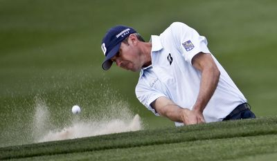 Matt Kuchar hits from a bunker on the 13th hole in his match against Bernd Wiesberger during the first round of the Match Play Championship golf tournament on Wednesday, Feb. 19, 2014, in Marana, Ariz. (AP Photo/Ted S. Warren)