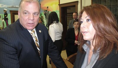 """New Jersey state Senate President Steve Sweeney, left, speaks with Yvonne Lopez, right, an official with the Puerto Rican Association for Human Development following a news conference in Perth Amboy N.J. on Feb. 19, 2014. Sweeney was pushing for his proposed """"Sandy Bill Of Rights,"""" saying Gov. Chris Christie's administration's handling of Superstorm Sandy aid has  been """"a colossal failure."""" (AP Photo/Wayne Parry)"""
