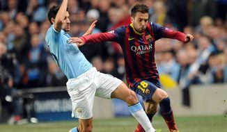 Manchester City's Jesus Navas, left, tackles Barcelona's Jordi Alba during their Champions League last-16 round soccer match at the Etihad Stadium in Manchester, England, Tuesday, Feb. 18, 2014. (AP Photo/Clint Hughes)