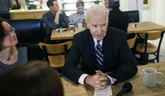 Vice President Joe Biden meets with women who have either signed up for coverage or have helped others sign up for insurance under the federal health care law  during a stop at Moose and Sadie's coffee shop Wednesday, Feb. 19, 2014, in Minneapolis. (AP Photo/Jim Mone, Pool)
