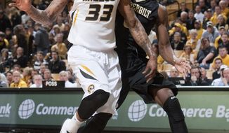 Missouri's Earnest Ross, left, has the ball knocked away from him by Vanderbilt's Rod Odom, right, during the first half of an NCAA college basketball game, Wednesday, Feb. 19, 2014, in Columbia, Mo. (AP Photo/L.G. Patterson)
