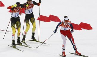 Norway's Joergen Graabak, right, is followed by Germany's Johannes Rydzek, left, and Germany's Bjoern Kircheisen during the cross-country portion of the Nordic combined individual Gundersen large hill competition at the 2014 Winter Olympics, Tuesday, Feb. 18, 2014, in Krasnaya Polyana, Russia. (AP Photo/Dmitry Lovetsky)