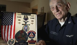 ADVANCE FOR USE SATURDAY, FEB. 22 AND THEREAFTER - In this Feb. 7, 2014 photo, Jim Hood, who served in the Civil Air Patrol for 30 years, poses for a photo at his home ion Decatur, Ill. Hood left the Civil Air Patrol in December 2013 at the age of 84. (AP Photo/Herald & Review, Jim Bowling)