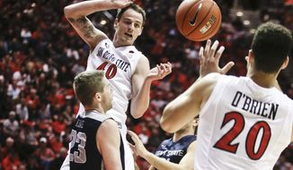 San Diego State forward Matt Shrigley releases a pass to JJ O'Brien after penetrating the lane during the first half of a NCAA college basketball game Tuesday, Feb. 18, 2014, in San Diego. (AP Photo/Lenny Ignelzi)