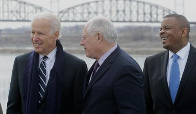 Vice President Joe Biden, accompanied by Illinois Gov. Pat Quinn, center, and Transportation Secretary Anthony Foxx, gather at America's Central Port in Granite City, Ill., Wednesday, Feb. 19, 2014, to mark the fifth anniversary of the American Recovery and Reinvestment Act (ARRA). (AP Photo/Seth Perlman)