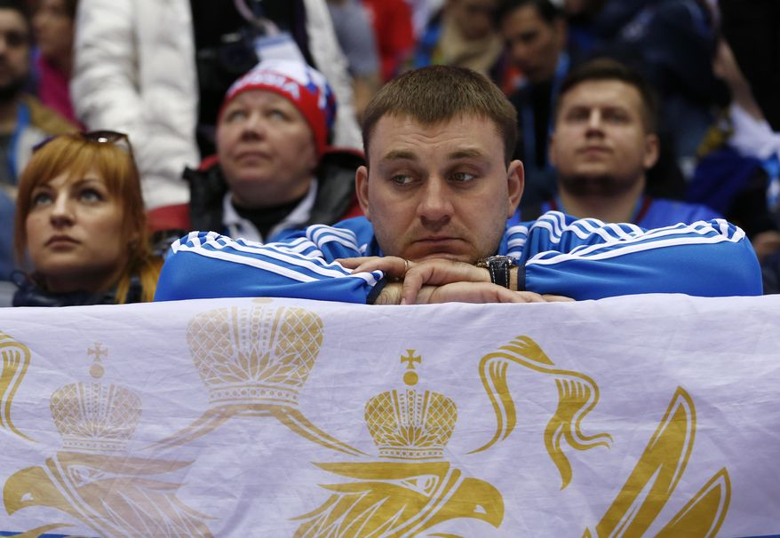 Russian hockey fans watch play against Finland in the third period of a men's quarterfinal ice hockey game at the 2014 Winter Olympics, Wednesday, Feb. 19, 2014, in Sochi, Russia. (AP Photo/Julio Cortez)
