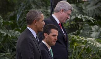 """President Barack Obama, Mexican President Enrique Peña Nieto, and Canadian Prime Minister Stephen Harper leave a photo opp  at the Cosmovitral stained glass botanical garden in Toluca, Mexico, Wednesday, Feb. 19, 2014, before the seventh trilateral North American Leaders Summit Meeting. This year's theme is """"North American Competitiveness."""" (AP Photo/Jacquelyn Martin)"""