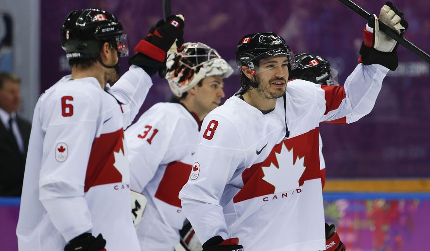 Canada defenseman Drew Doughty celebrates with teammates after Canada defeated Latvia 2-1 during a men's quarterfinal ice hockey game at the 2014 Winter Olympics, Wednesday, Feb. 19, 2014, in Sochi, Russia. (AP Photo/Julio Cortez)