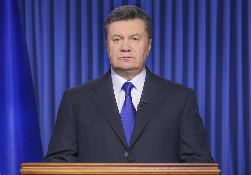 """Ukrainian President Viktor Yanukovych addresses the nation on a live TV broadcast in Kiev, Ukraine, early Wednesday, Feb. 19, 2014. In a statement published online early Wednesday, Yanukovych blamed opposition leaders for the violence, saying that they had """"crossed a line when they called people to arms."""" (AP Photo/Andrei Mosienko, Pool)"""