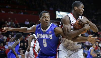 Rutgers Malik Kone holds on to the ball as Memphis forward Nick King  (5) tries to make a steal during the first half of an NCAA college basketball game Thursday, Feb. 20, 2014, in Piscataway, N.J. (AP Photo/Mel Evans)