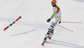 Germany's Stefan Luitz arrives in the finish area on one ski after hitting a gate in the first run of the men's giant slalom at the Sochi 2014 Winter Olympics, Wednesday, Feb. 19, 2014, in Krasnaya Polyana, Russia.  (AP Photo/Gero Breloer)